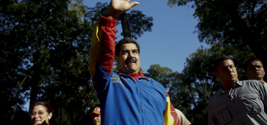 Venezuela's President Nicolas Maduro waves to supporters during his visit to the sixth Book Fair in Caracas, July 25, 2015. REUTERS/Carlos Garcia Rawlins