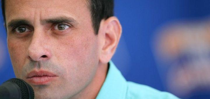 Opposition frontrunner presidential candidate Henrique Capriles Radonski speaks to the foreign media in Caracas