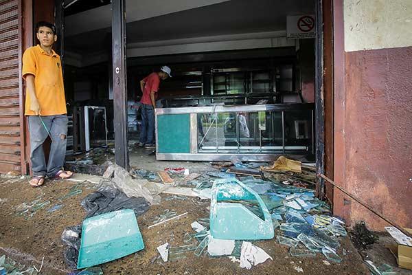 Saqueos en Ciudad Bolívar dejaron graves consecuencias al sector comercial |Foto: Reuters