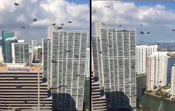 Billetes de 100 fueron lanzados desde ventanas en Miami   Imagen: Captura de video