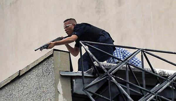 Civil armado dispara desde la azotea del TSJ | Foto: EFE